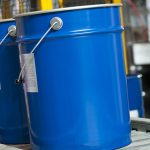 Paint bucket on conveyor. Fragment paint factory